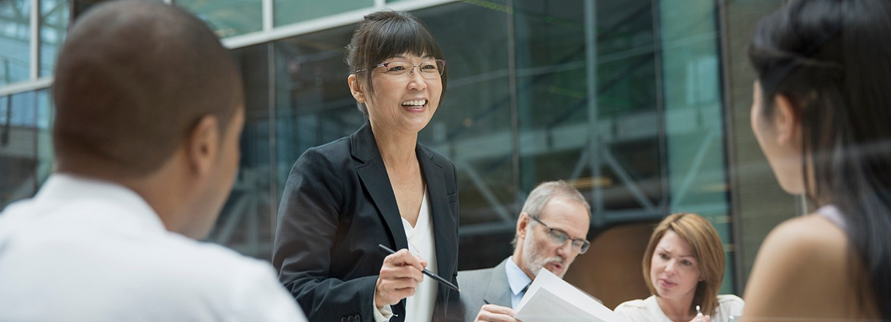 Businesswoman leading meeting in conference room, asian