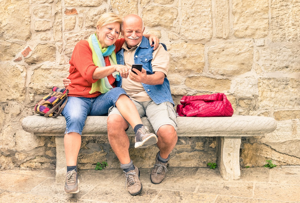 Senior couple taking a selfie on smart phone, mobile, happy, smiling, retirement, travel