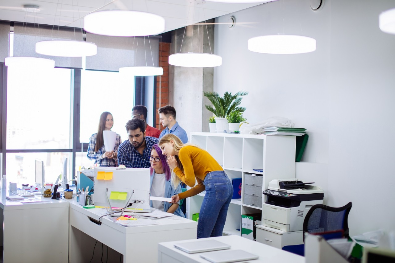 Group of young people in modern office discussing a new project, diverse, computer, laptop